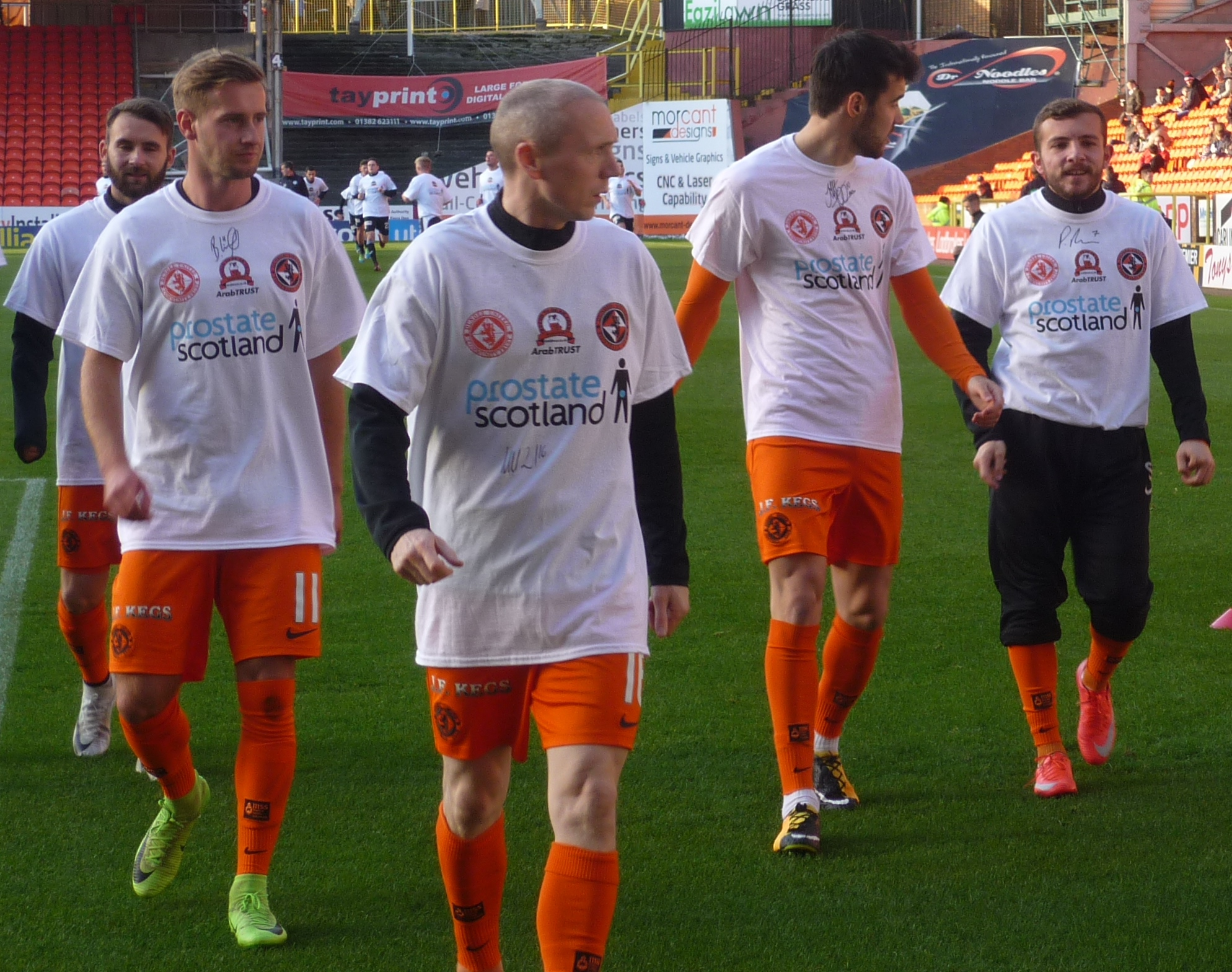 Dundee United warming up in Prostate Scotland t shirts