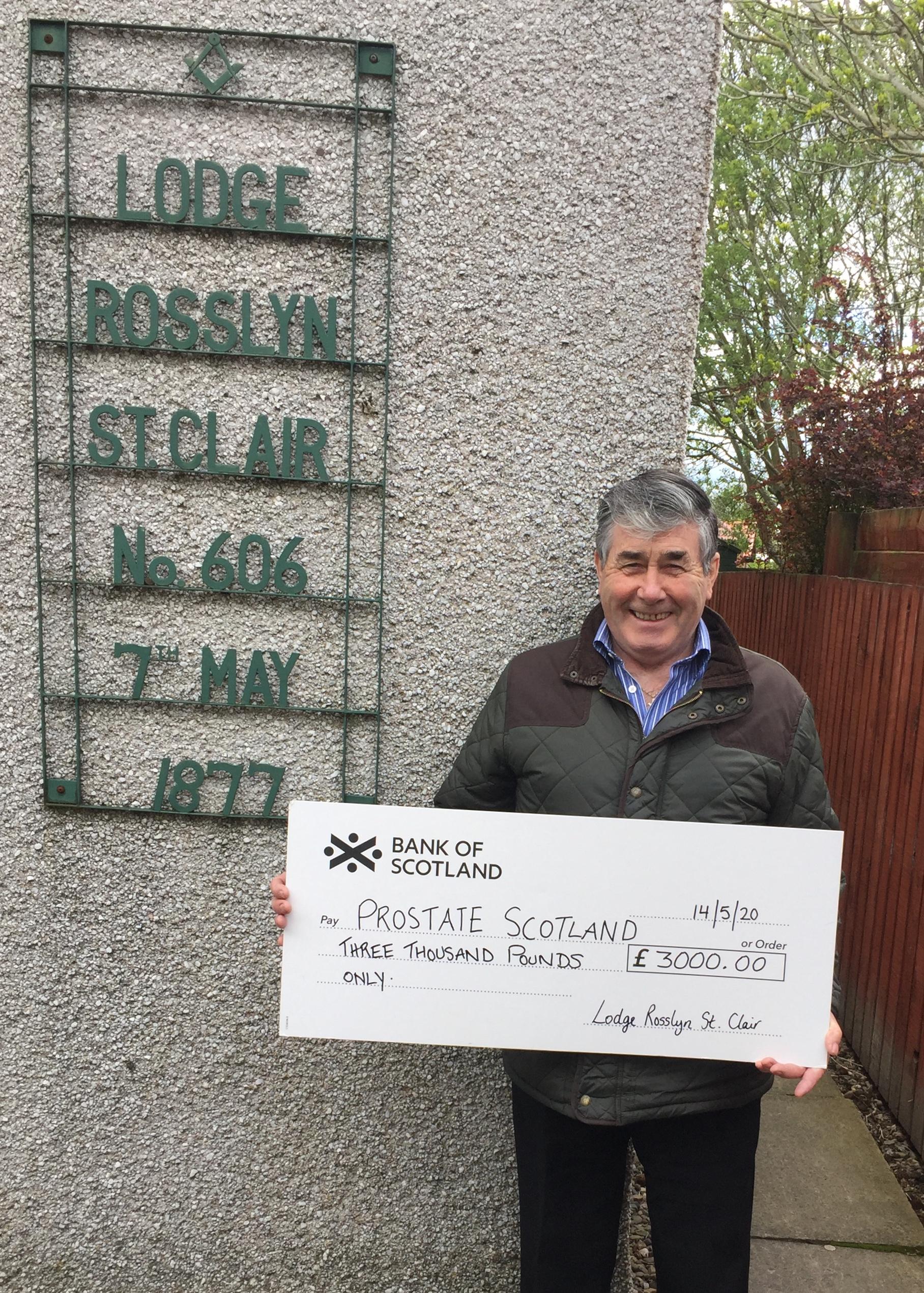 Alex Barrett presenting cheque to Prostate Scotland